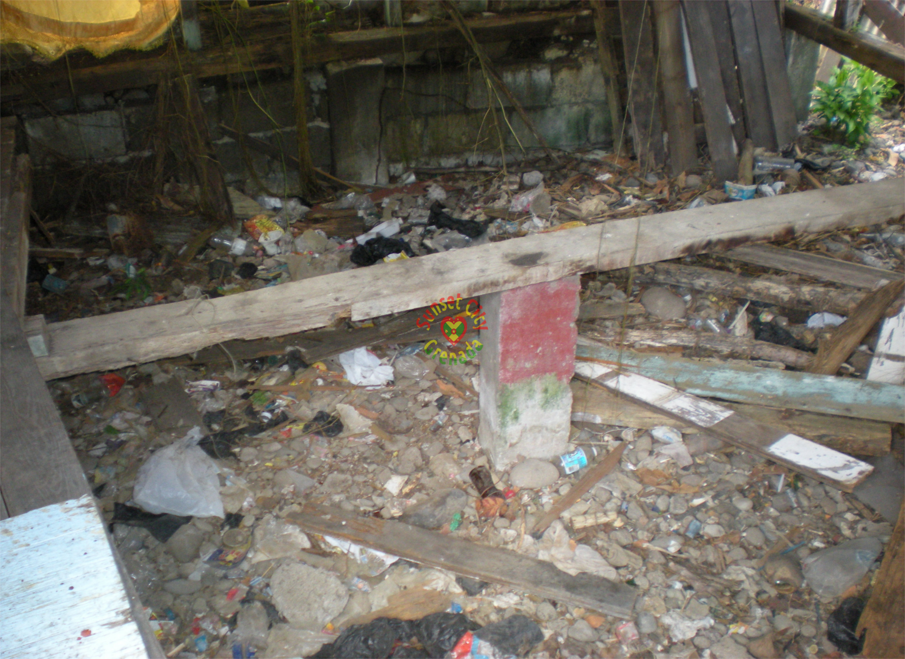 Garbage dumped in abandon building to the right of St. David's street