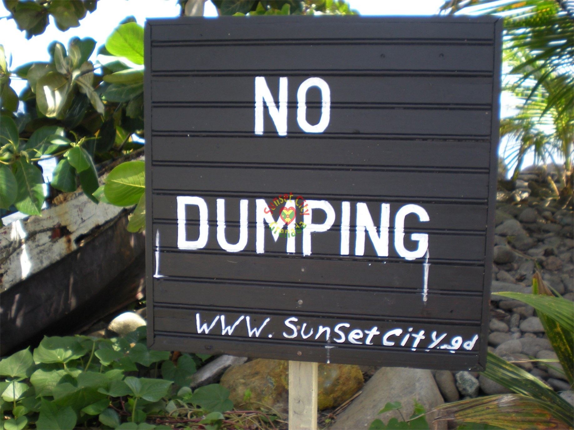 No Dumping sign - sponsored by Sunset City Grenada